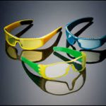 Customised glasses prototypes with yellow green and blue frames and clear lenses