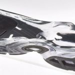 Sport shoe sole prototype with clear and black rubber regions
